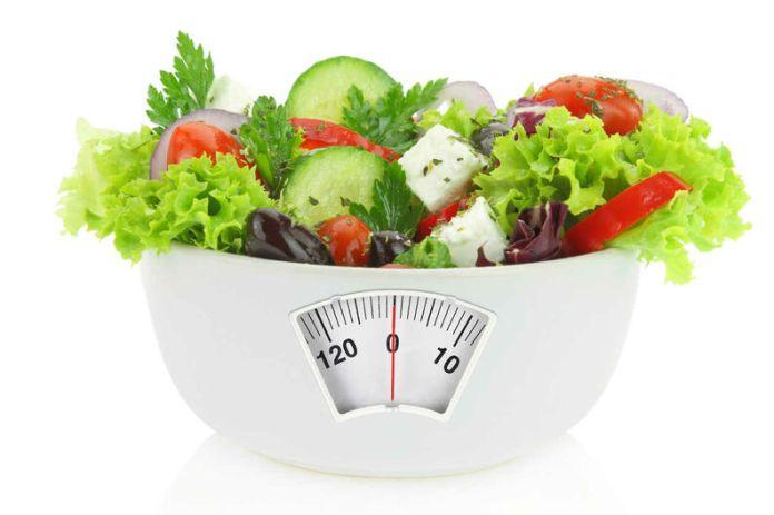 Cuántas calorías debe comer por día para bajar de peso?