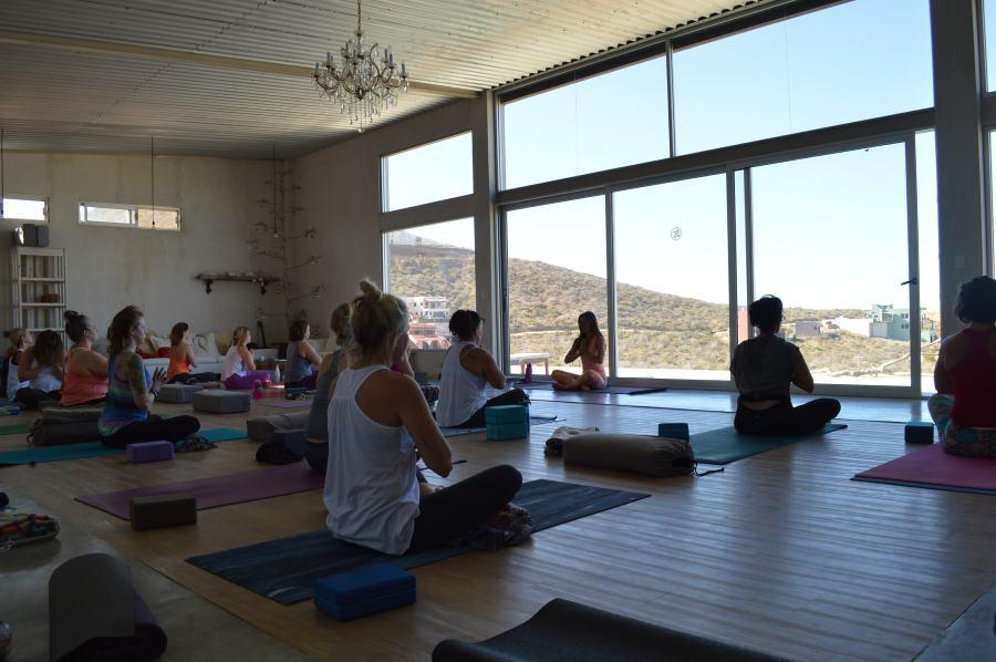 yoga class meditates in southern baja