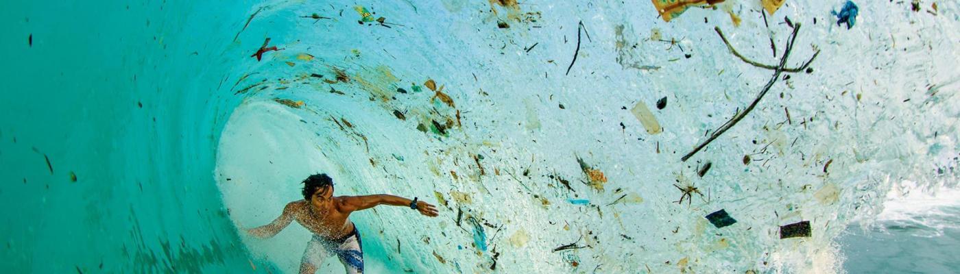 surfer barreled by plastic