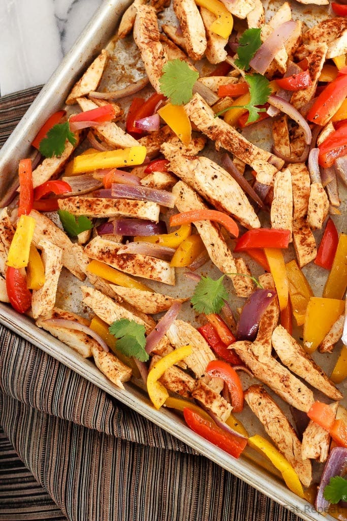 Quick and easy chicken fajitas with just one sheet pan to clean afterwards! This is my new favourite way to make one of my family's favourite meals!