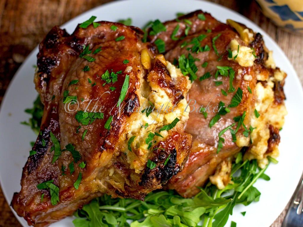 Fontina & Caramelized Onion Stuffed Pork Chops   bakeatmidnite.com   #porkchops #fontina #caramelizedonions