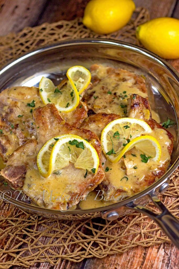 Pork Chops with Lemon Thyme Cream Sauce | bakeatmidnite.com | #porkchops #lemoncreamsauce #30minutemeals