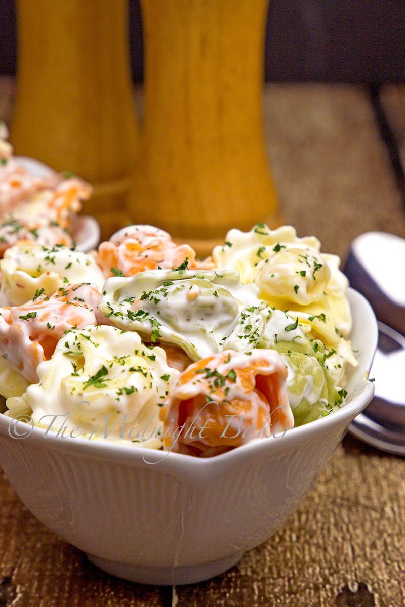 Multicolored cheese tortellini in a creamy Italian sauce