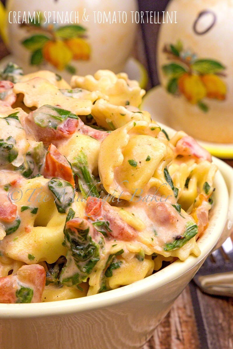 Tortellini with fire roasted tomatoes and spinach in a creamy sauce