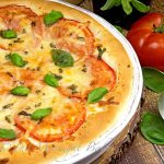 Deep dish pizza filled with fresh tomatoes, basil and 3 cheeses