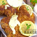 Pork chops with a crunchy seasoned crust made even better with a cheesy and lemony herb gravy