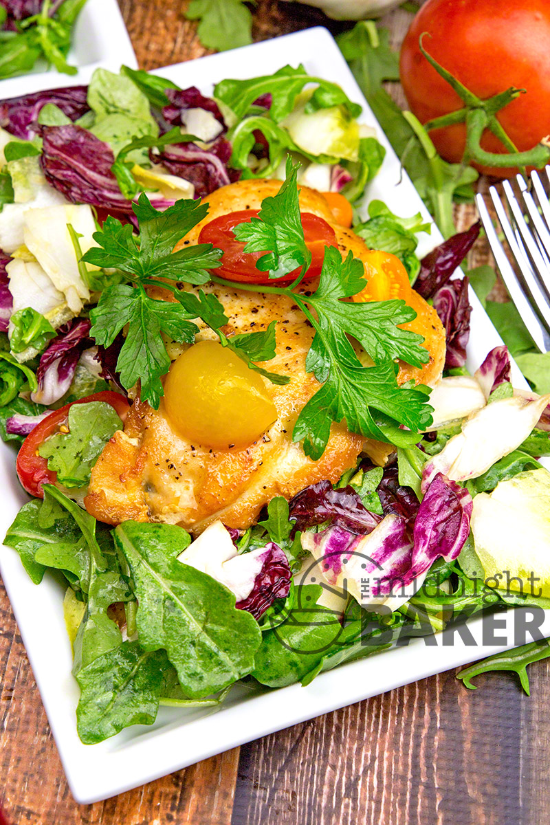 A simple sauteed chicken breast on a bed of arugula, radicchio and Belgian endive with a warm vinaigrette.