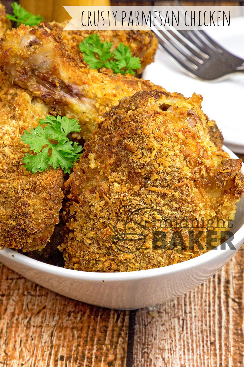 Juicy baked parmesan chicken with a crusty crumb coating.