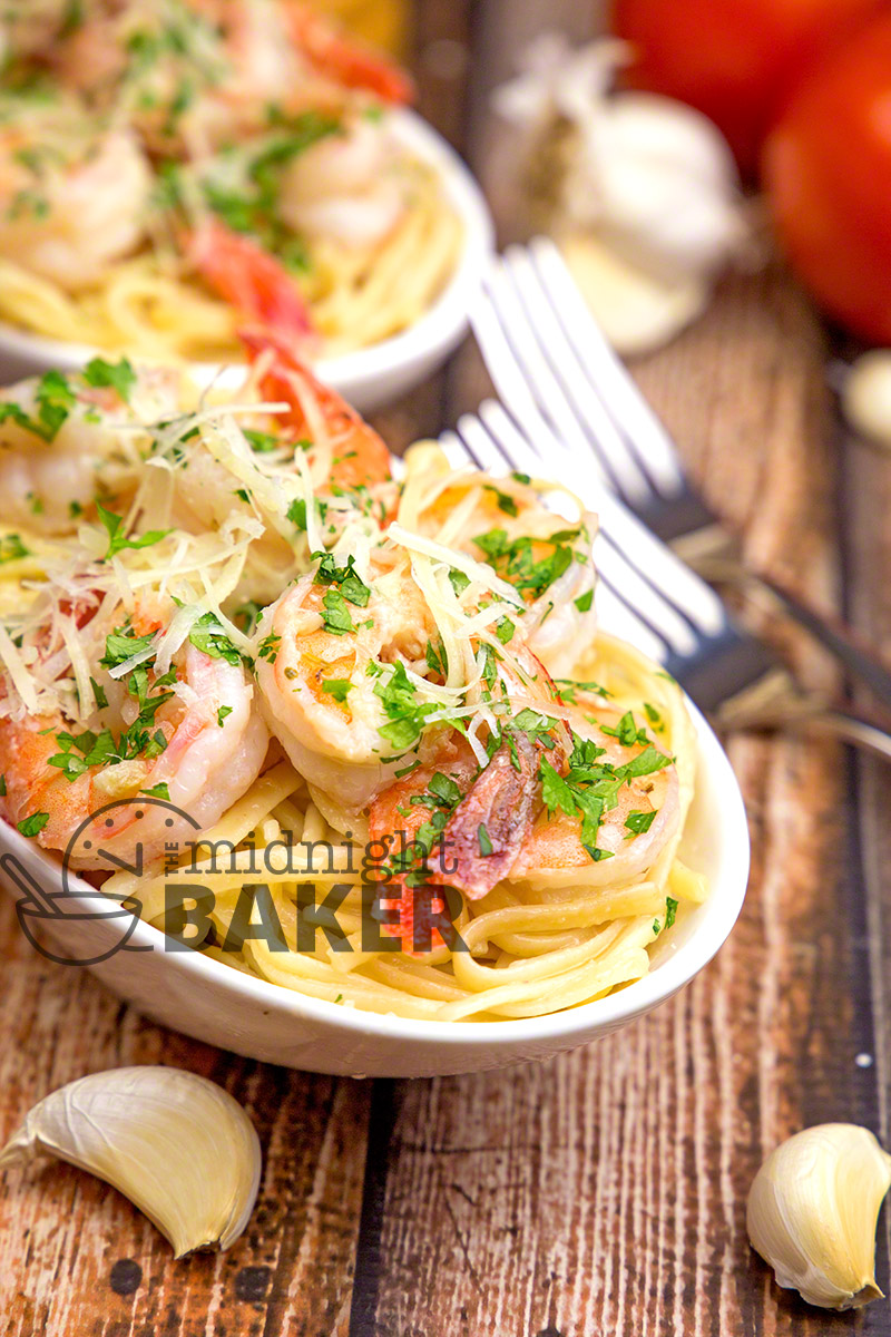 Delicious garlicky shrimp scampi served with a bed of pasta in an olive oil and butter herb sauce