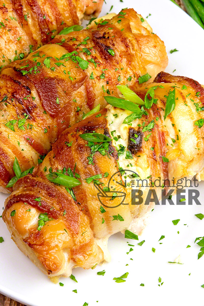 Stuffed chicken breasts wrapped in bacon and filled with a flavorful vegetable cream cheese.