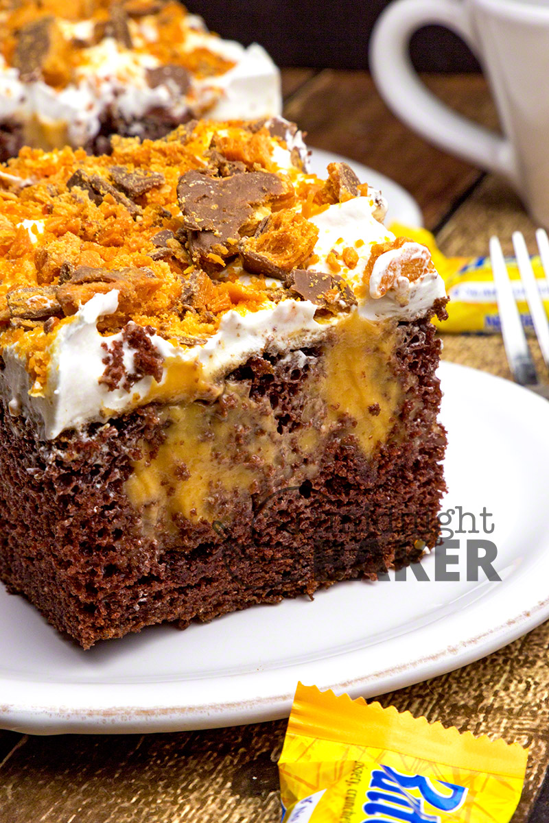 Perfect for chocolate lovers and Butterfinger lovers alike! This poke cake not only has crushed Butterfingers on top, the cake itself is a copycat of the candy bar!