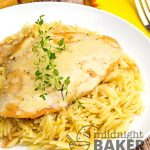 chicken in butter sauce on plate of buttery orzo