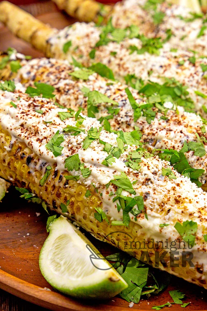 What a great way to serve corn! Mexican Street Corn is grilled then covered in a wonderful creamy crema enhanced by chili and cotija cheese.