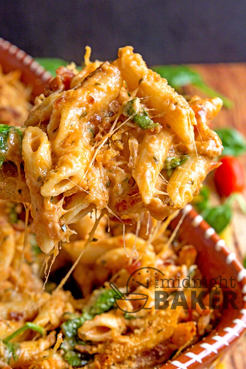 This pasta bake is a cheese lover's dream! Delicious pesto-flavored sauce and bacon make it a winner. Can be frozen too!