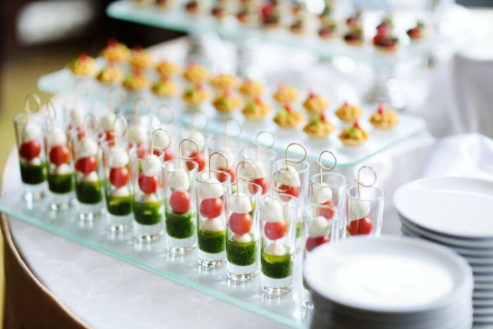Plates with assorted finger food snacks on an event party or dinner