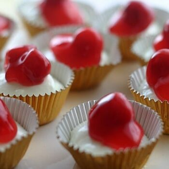 Upclose view of the mini cheesecakes on a cake stand