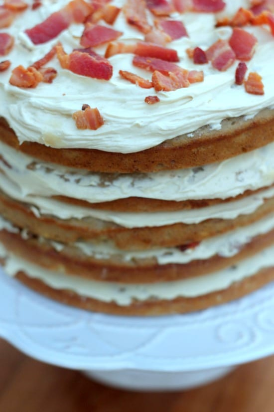 An upclose view of the cake with visible layers on the sides and crumbled bacon on top