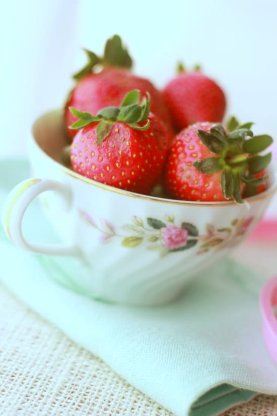 Fresh strawberries in a teacup