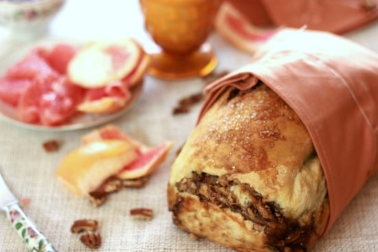 Cardamom Pecan Swirl Bread wrapped in a cloth
