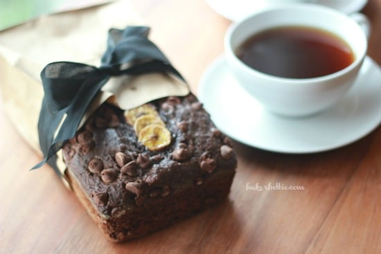 Dark Chocolate Banana Bread with Cayenne loaf with a cup of coffee