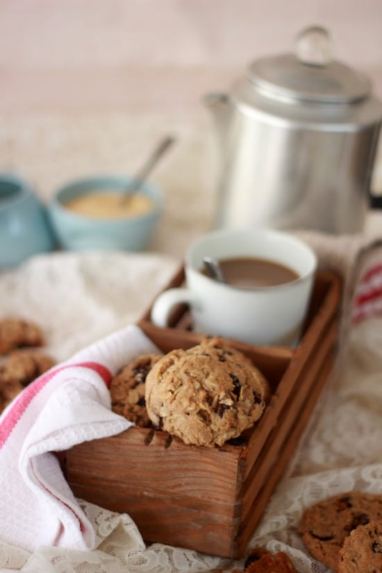 Oatmeal Spiced Rum Raisin Cookies in a basket with a cup of coffee