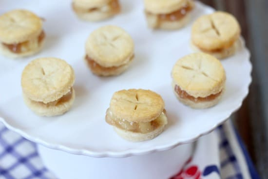 Mini Apple Pie Sandwich Cookies on a cake stand