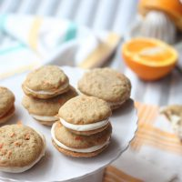 Carrot Cake Whoopie Pies on a cake stand