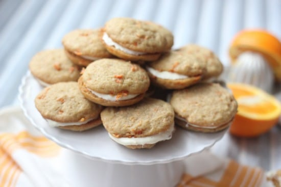 Carrot Cake Whoopie Pies stacked up on a cake stand