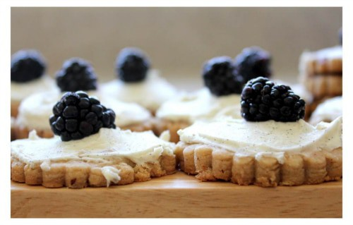 A side view of the Hazelnut Shortbread topped with Mascarpone and Blackberries