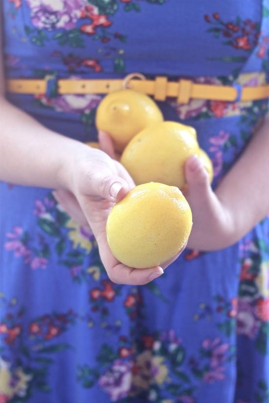 Me holding 3 lemons