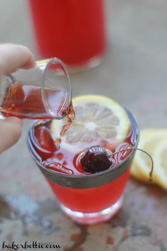 Adding spiced rum to the cherry lemonade