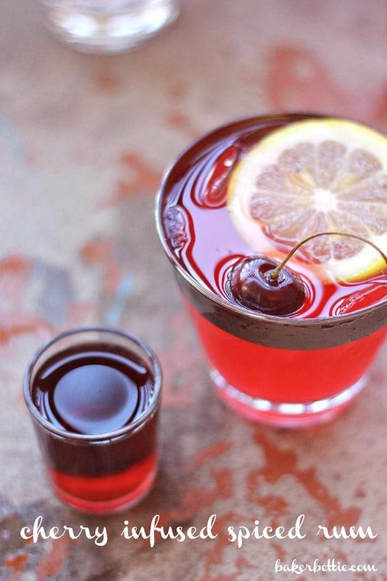 Spiced rum shot beside cherry lemonade glass