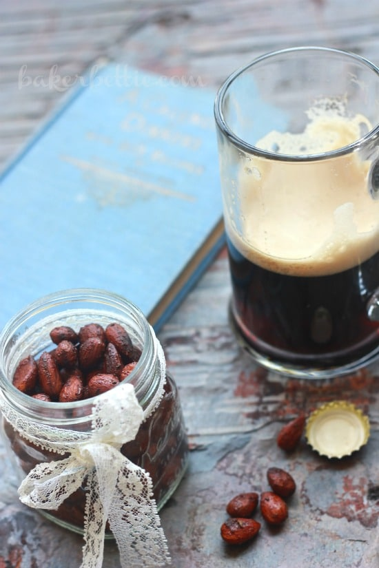 Sweet and Spicy Smoked Almonds in a jar beside a glass of beer