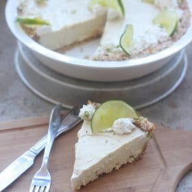 Slice of Key Lime Cashew Cream Pie with lime slice on top with fork