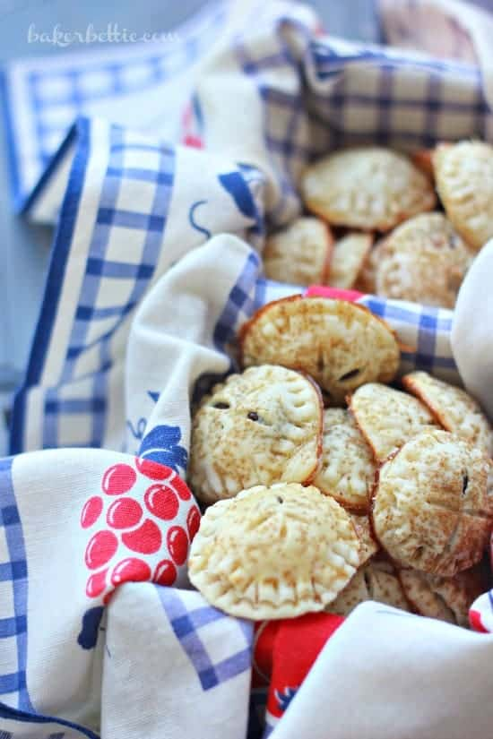 Mini Chocolate Hand Pies on a basket with a floral cloth