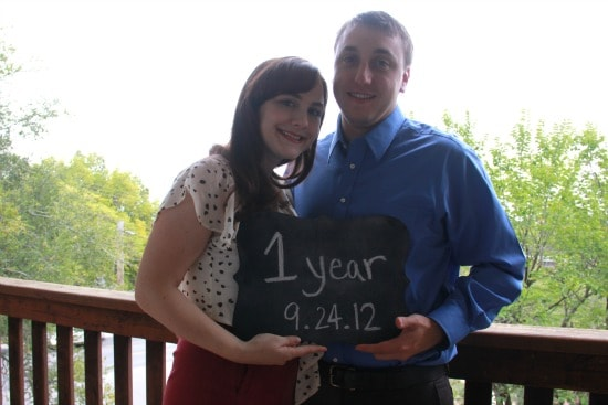 """My husband and I with a sign that reads """"1 Year/ 9.24.12"""""""