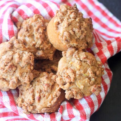 Apple Muffins with Streusel topping in a basket with a cloth