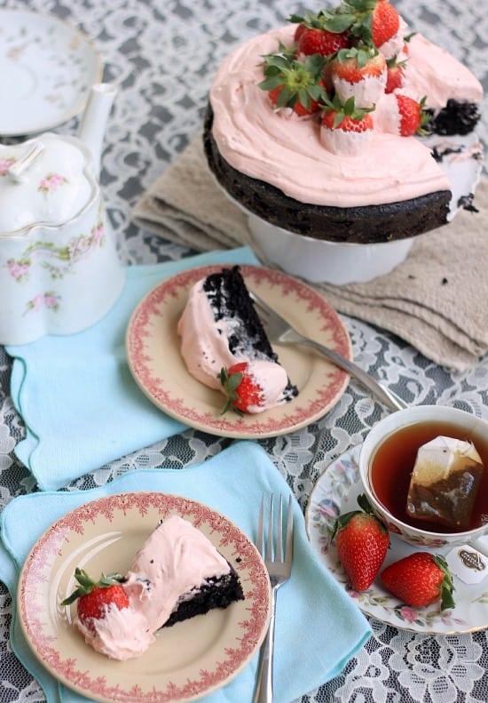 Slices of White Chocolate Covered Strawberry and Dark Chocolate Fudge Cake