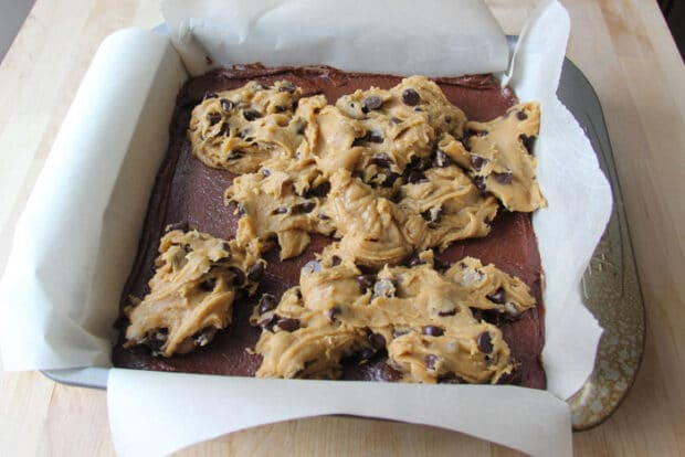 Dollops of chocolate chip cookie dough over the brownie batter before being spread out for the brookies