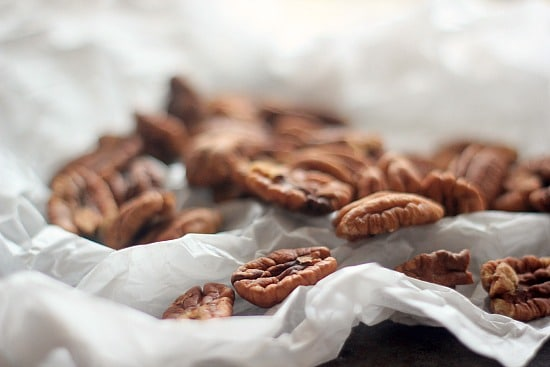 Pecan halves on parchment paper