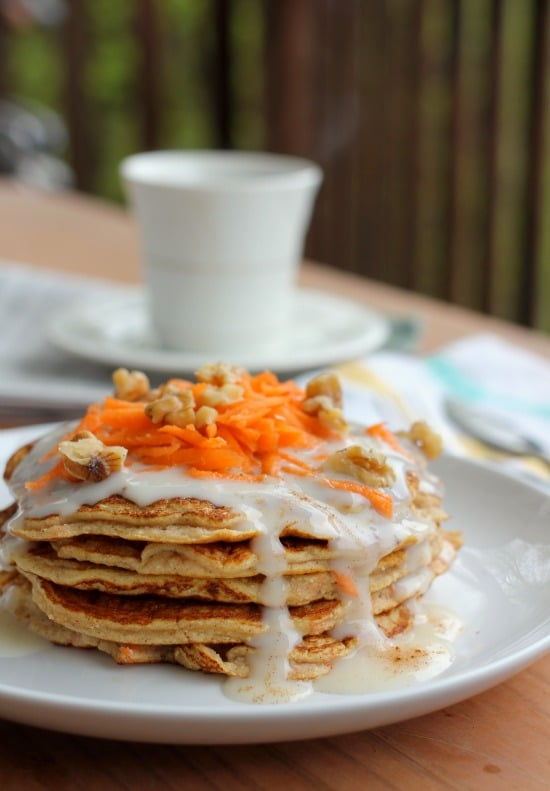 Carrot Cake Pancakes with Cream Cheese Maple Syrup stacked on a plate