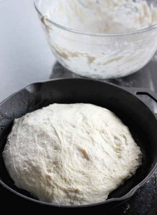 Raw bread dough ball in a cast iron skillet