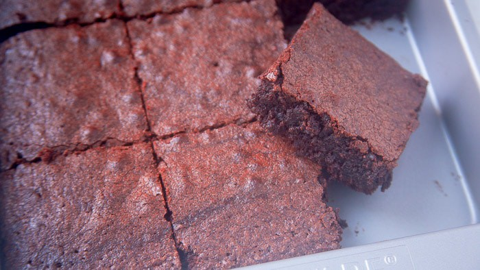 Chewy cocoa powder brownies cut in squares