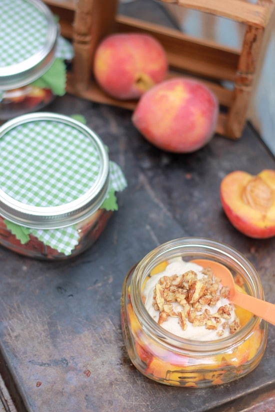 Peaches and Cream in a mason jar topped with pecans