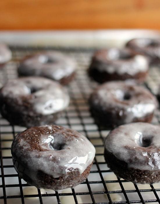 Mini Chocolate Glazed Donuts on a wire rack