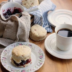 A Buttermilk Bacon Biscuit sandwiched with Blackberry Jam and Butter