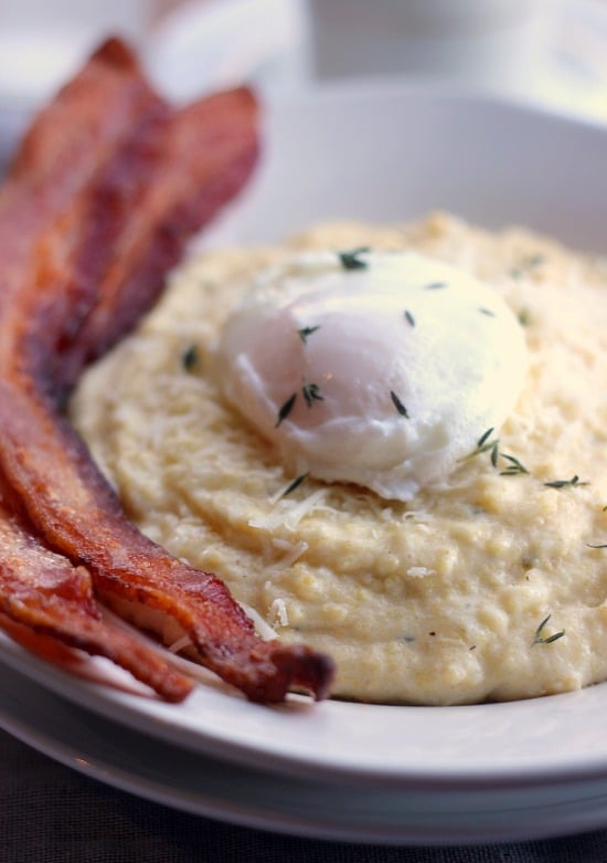 Creamy Breakfast Polenta in a bowl with bacon and a poached egg on top
