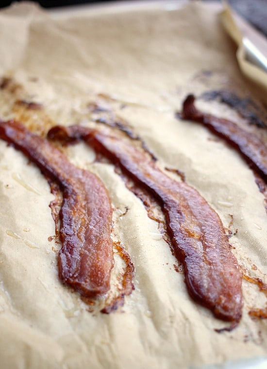 Cooked bacon slice on parchment
