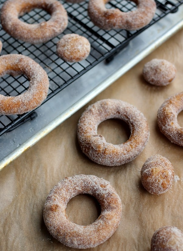 Puff Pastry Donuts rings stacked up with donut holes dipped in cinnamon sugar