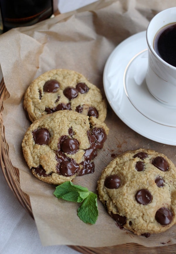 Fresh Mint Chocolate Chip Cookies beside a cup of coffee